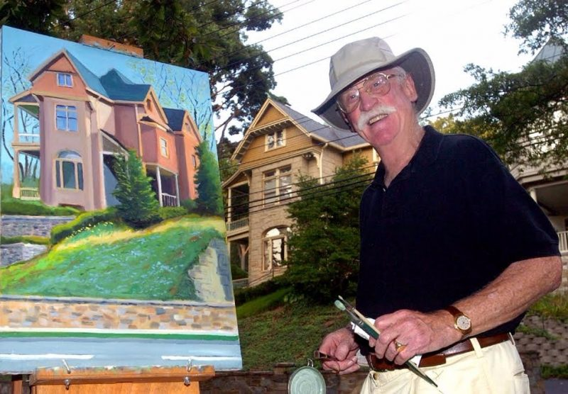 This photograph of Fred Pelzman was taken on MacArthur Boulevard in Washington by a photographer for Current newspapers as the artist was painting the house shown in the background.