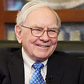 In this May 6, 2013 photo, Warren Buffett smiles during a television interview in Omaha, Neb. The annual charity auction of a private lunch with billionaire investor Warren Buffett has entered its final hours with the rare opportunity still available for the relative bargain price of less than a million dollars. The auction has drawn bids of more than $2 million in each of the past five years, and last year it fetched a record $3,456,789. (AP Photo/Nati Harnik)