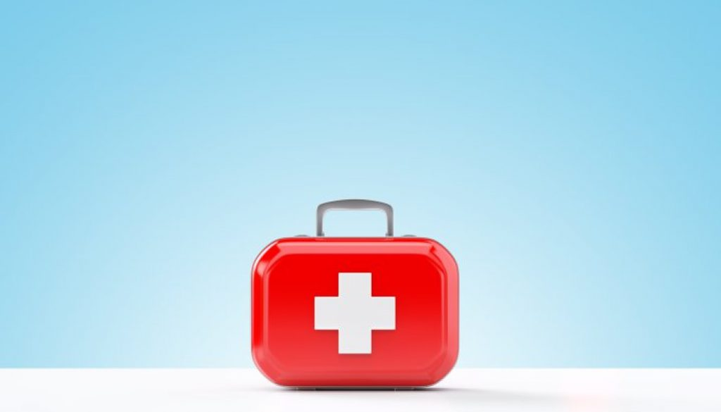 First aid kit standing on a blue and white background